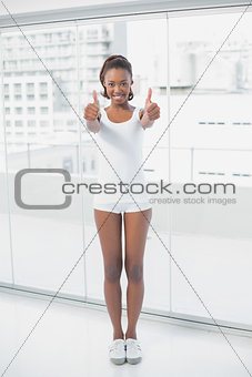 Slender athletic woman giving thumbs up
