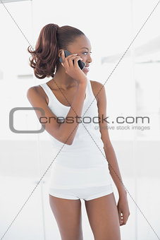 Fit cheerful woman on the phone