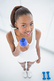 High angle view of relaxed fit woman holding flask