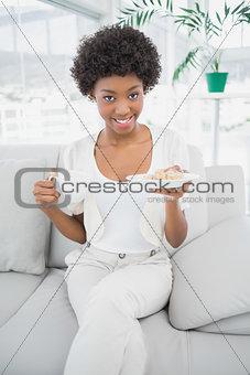 Smiling brunette having breakfast