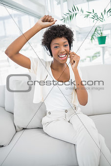 Pretty woman dancing while listening to music