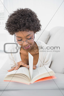 Focused gorgeous brunette reading book