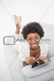 Smiling gorgeous brunette using digital computer