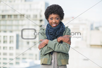 Shivering casual woman posing outdoors