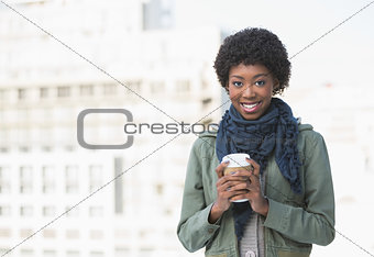 Happy casual woman holding coffee