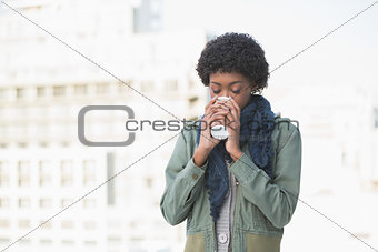 Happy casual woman drinking coffee