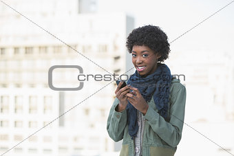 Cheerful afro model texting