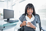 Smiling businesswoman holding mug