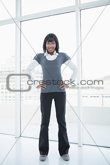 Businesswoman standing in bright office
