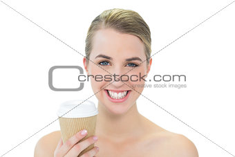 Smiling attractive blonde holding mug of coffee