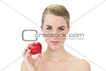 Attractive blonde holding red apple