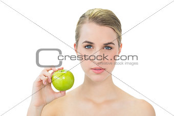 Attractive blonde holding green apple