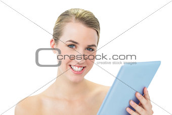 Smiling attractive blonde using tablet pc