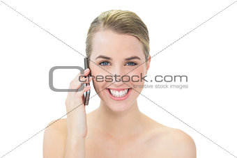 Smiling attractive blonde on the phone