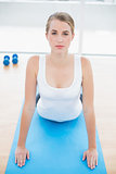 Fit woman stretching on sport mat