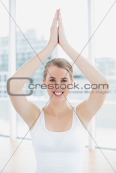 Smiling fit woman doing yoga session