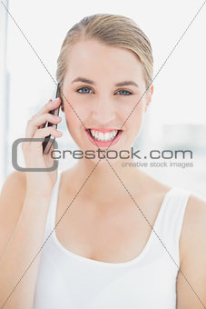 Close up on happy sporty woman having a phone call
