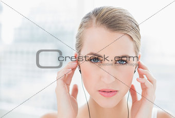 Close up on sporty woman listening to music