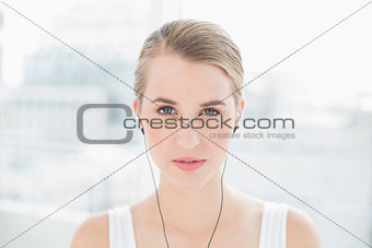 Close up on peaceful sporty woman listening to music
