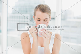 Blond woman drinking coffee
