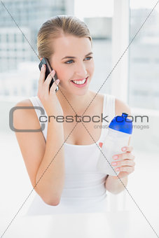 Smiling blond woman having a phone call