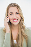 Happy pretty blonde on the phone