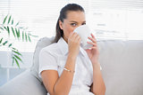 Peaceful attractive woman drinking coffee