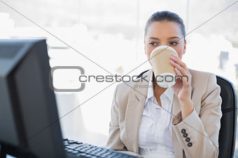 Relaxed sophisticated businesswoman drinking coffee