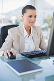 Concentrated businesswoman working on computer