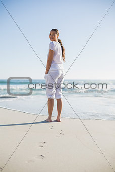 Rear view of smiling woman looking at camera