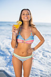 Cheerful attractive woman in bikini holding cocktail