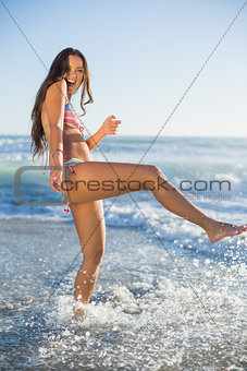Laughing woman in bikini having fun in the sea