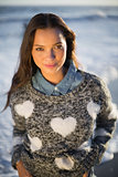Smiling gorgeous woman with pullover posing