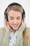 Happy cute blonde listening to music