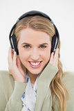 Smiling cute blonde listening to music