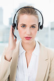 Serious pretty call centre agent wearing headset