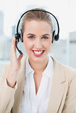 Smiling pretty call centre agent wearing headset