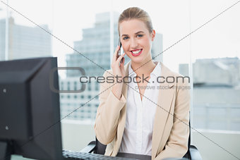 Cheerful attractive businesswoman on the phone