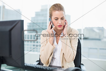 Worried attractive businesswoman on the phone