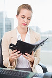 Serious attractive businesswoman holding her agenda