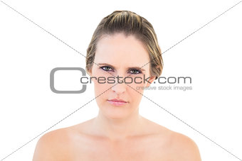 Portrait of woman looking angry at camera