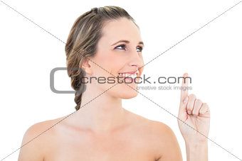 Cheerful woman pointing and looking up