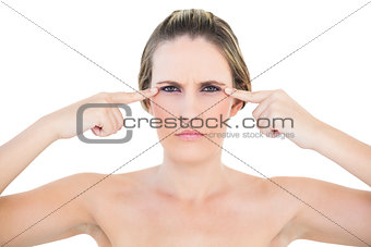 Angry woman pointing to eyes looking at camera