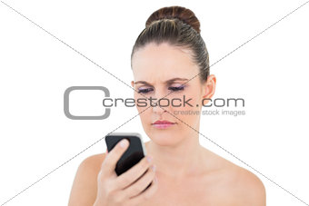 Angry woman looking at her phone