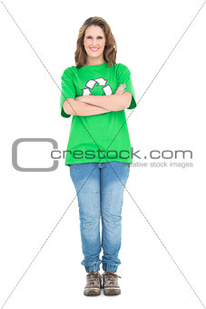 Woman wearing green tshirt with recycling symbol crossing arms