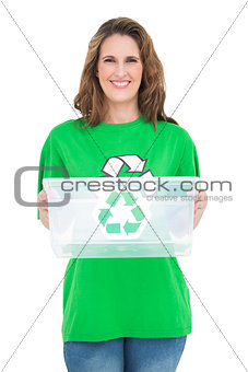 Smiling activist holding recycling box