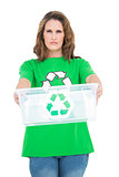 Serious environmental activist holding recycling box