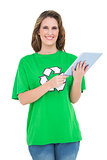 Smiling environmental activist using digital tablet