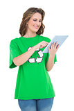 Smiling environmental activist using tablet