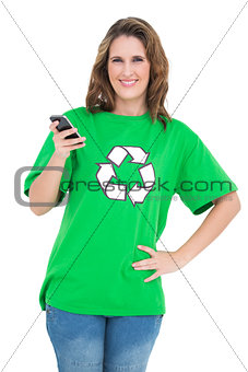 Smiling environmental activist holding phone looking at camera